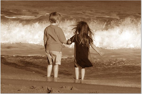 Children holding hands on the Beach